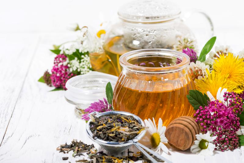 Fresh flower honey, tea and ingredients on white wooden background royalty free stock images