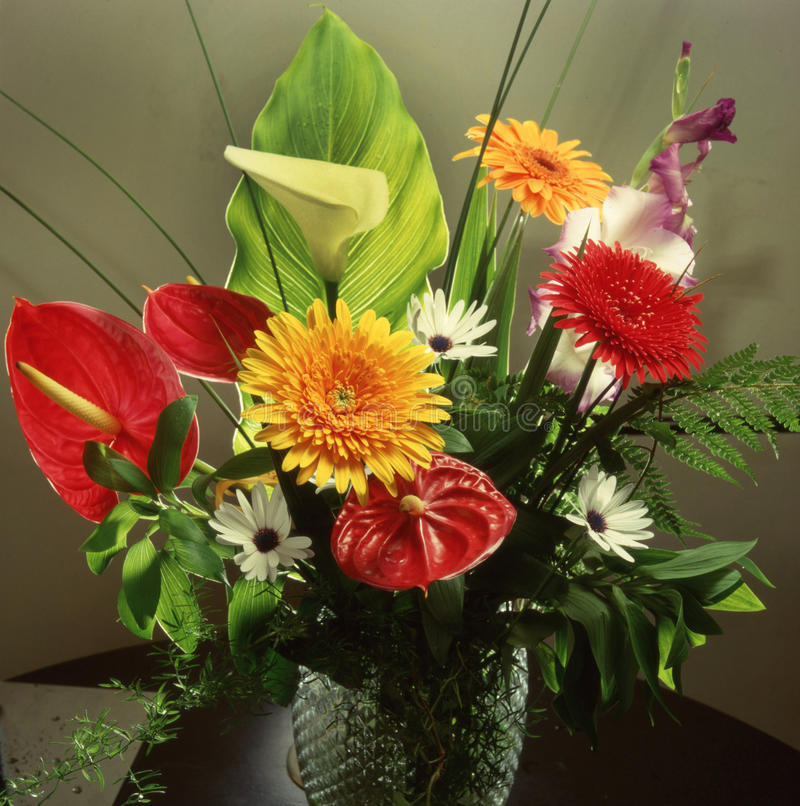 Fresh flowers in a vase. Bouquet of fresh flowers placed in a vase stock photography