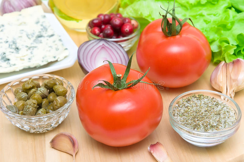 Fresh food close-up - horizontal photo. Fresh food. tomatoes, garlic, onions, capers, cheese and cranberries close-up - horizontal photo stock images