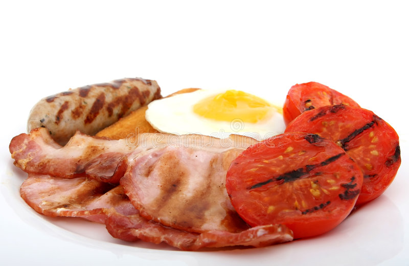 Fresh food, fried english breakfast. Fresh food, full fried english breakfast, macro closeup, close up over white with copy space royalty free stock photos