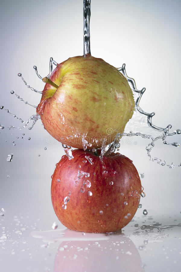 Fresh Food. Two apples in water stock photos
