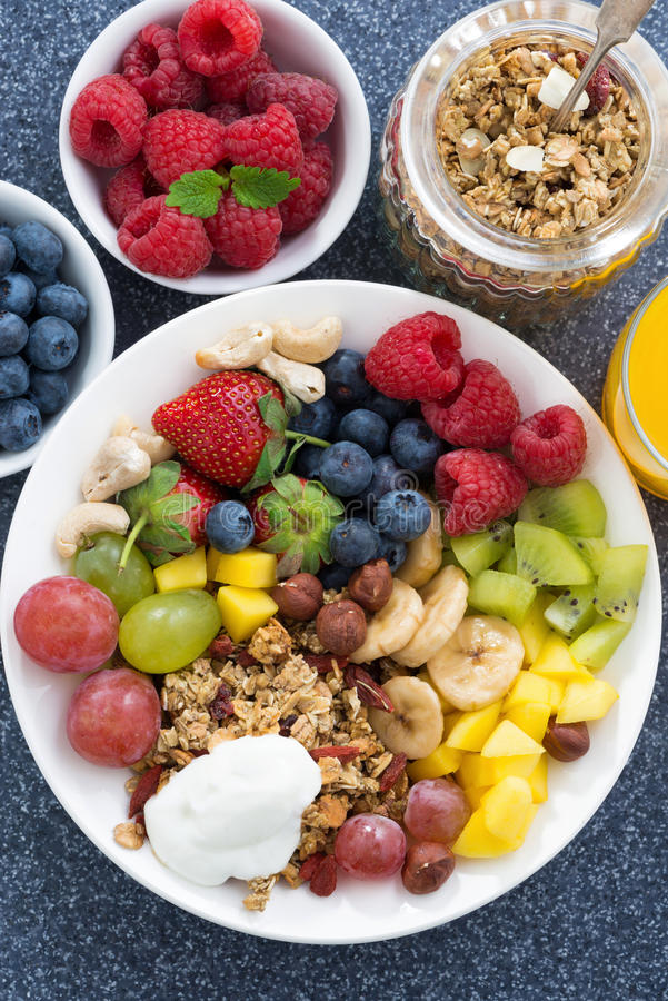 Fresh foods for a healthy breakfast - berries, fruits, nuts royalty free stock photos