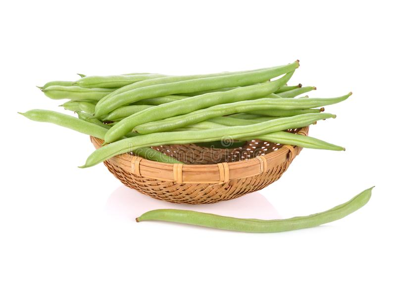 Fresh french bean in bamboo basket on white background. Fresh french bean in bamboo basket on a white background royalty free stock photos