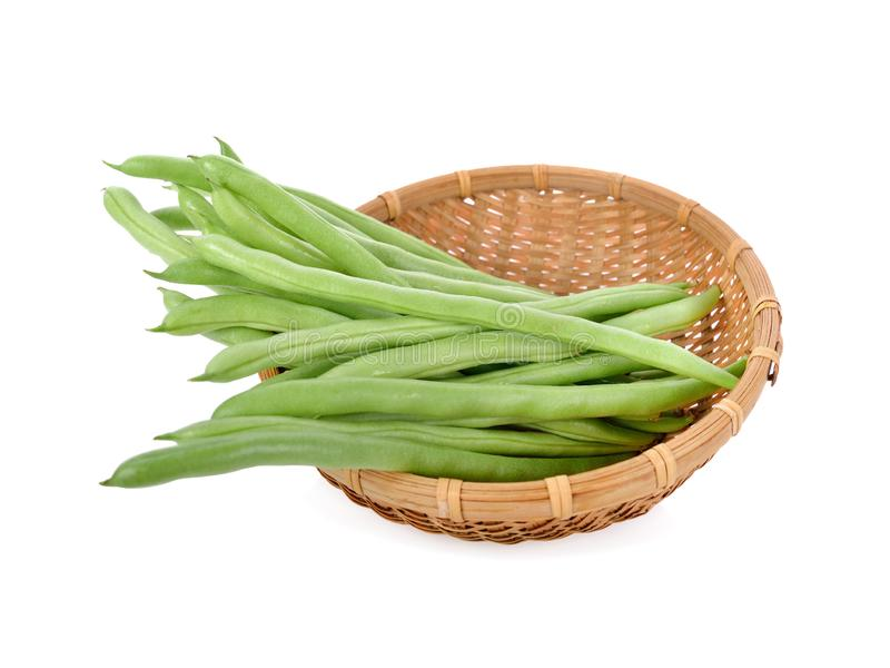 Fresh french bean in bamboo basket on white background. Fresh french bean in bamboo basket on a white background stock image
