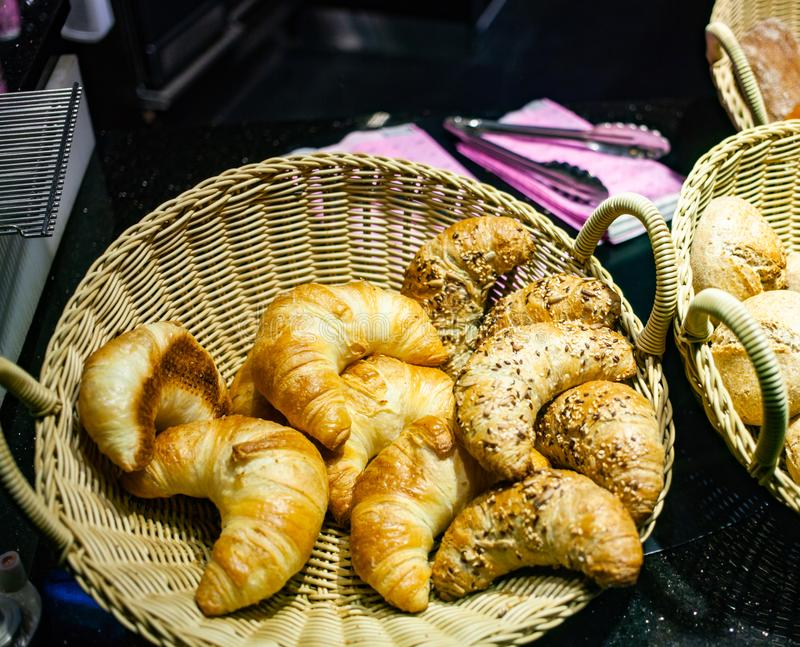 fresh French croissants in a basket stock image