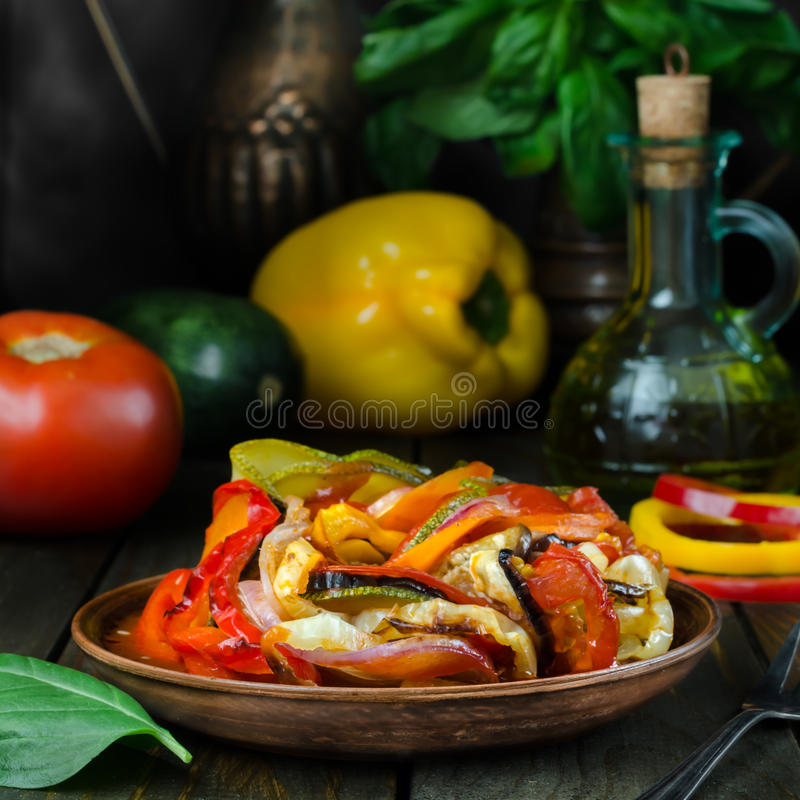Fresh French ratatouille in crockery plate, still life. Fresh French ratatouille in crockery plate royalty free stock photography