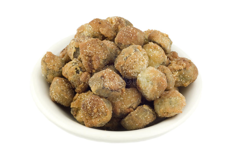 Fresh Fried Okra. A bowl of breaded fresh fried okra, isolated on white background, horizontal with copy space stock photos