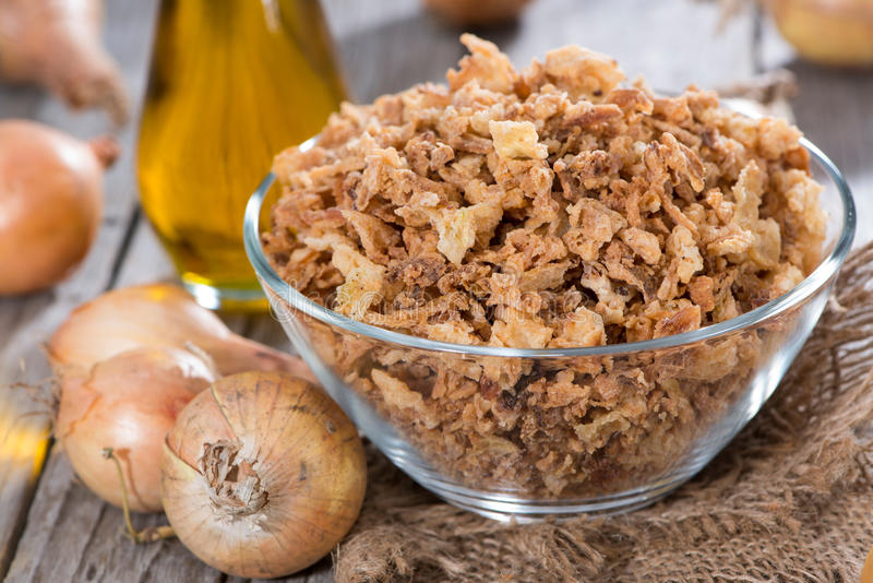 Fresh Fried Onions. Portion of fresh Fried Onions on wooden background stock photography