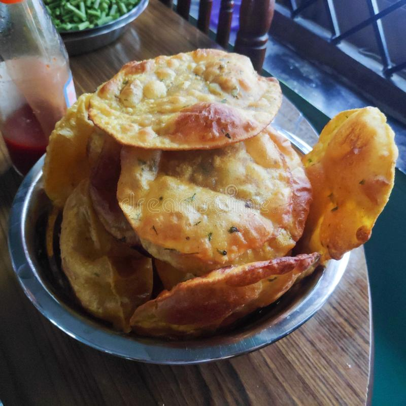 Fresh Fried pooris for breakfast. Indianbread, wheat, brown, crispy, indianfood, sauce, ketchup stock images