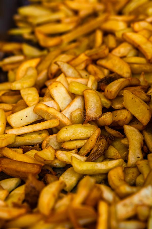 Fresh fried potatoes, french fries at a street food festival.  stock image