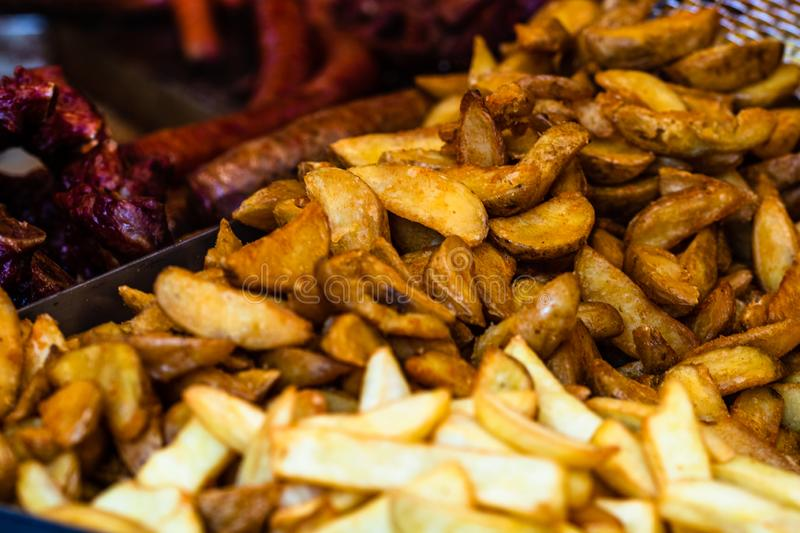 Fresh fried potatoes, french fries at a street food festival.  royalty free stock image