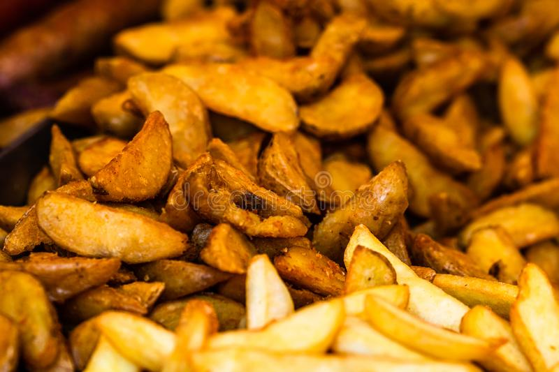 Fresh fried potatoes, french fries at a street food festival.  royalty free stock images