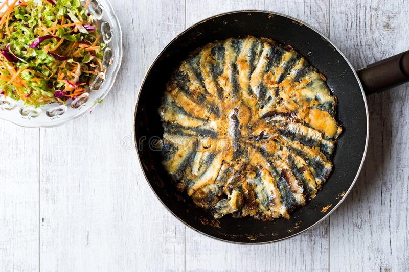 Fresh Fried Sardines / Anchovy Hamsi Tava in Pan on Wooden Surface. royalty free stock photo