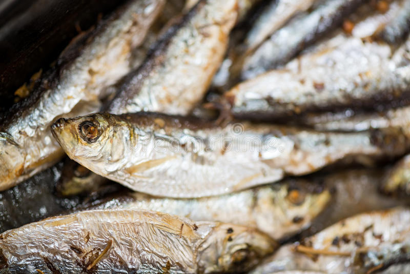 Fresh Fried Smelts. Fresh crispy fried Smelts in the pan. Close-up royalty free stock images
