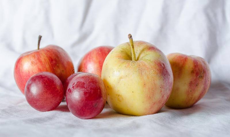 Fresh fruit apples and grapes royalty free stock photos