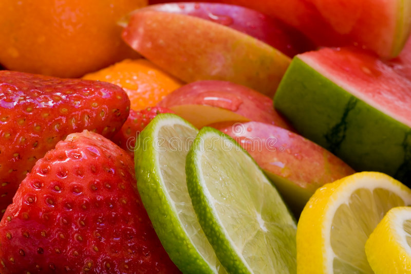 Fresh Fruit Assortment. Assortment of fresh fruit, limes, watermelon, lemons, strawberries, apples, oranges royalty free stock photo