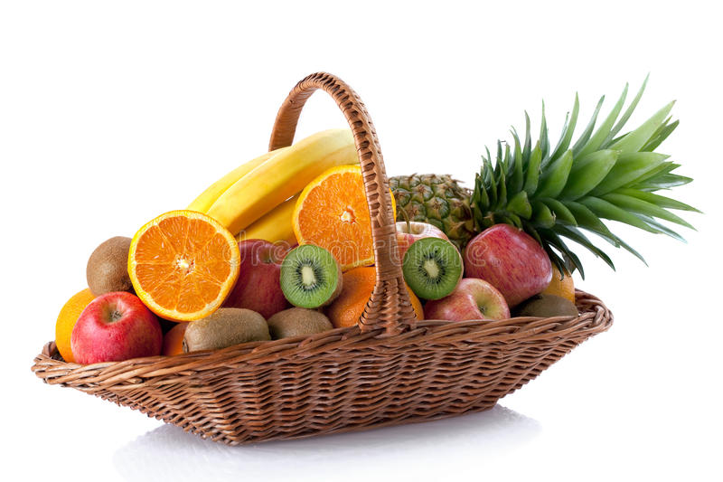 Fresh fruit in the basket. Against a white background stock photography