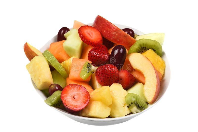 A bowl of fresh cut fruit. Isolated on white fruits include, Strawberry, Pineapple, Apple, Cantaloupe, Honeydew Melon, Kiwi and Gr royalty free stock photo