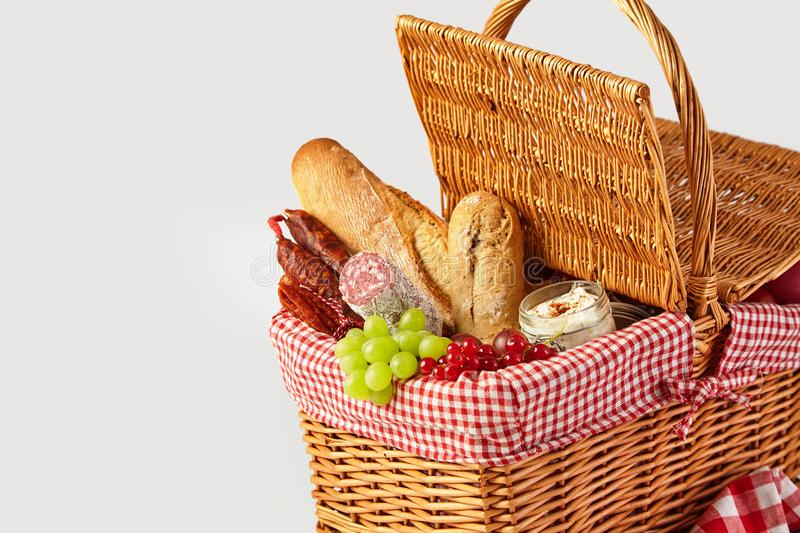 Fresh fruit, bread and cheese in a picnic basket royalty free stock images