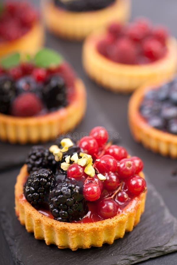 Fresh fruit cakes stock images
