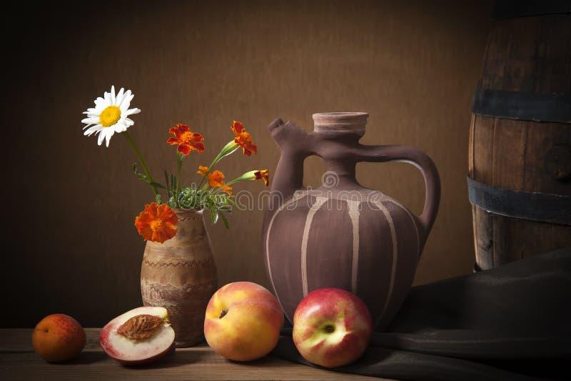 Fresh fruit and ceramic jug royalty free stock photo