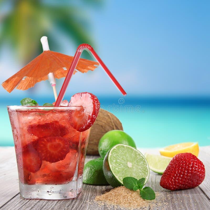Fresh fruit drink. On a beach royalty free stock photos