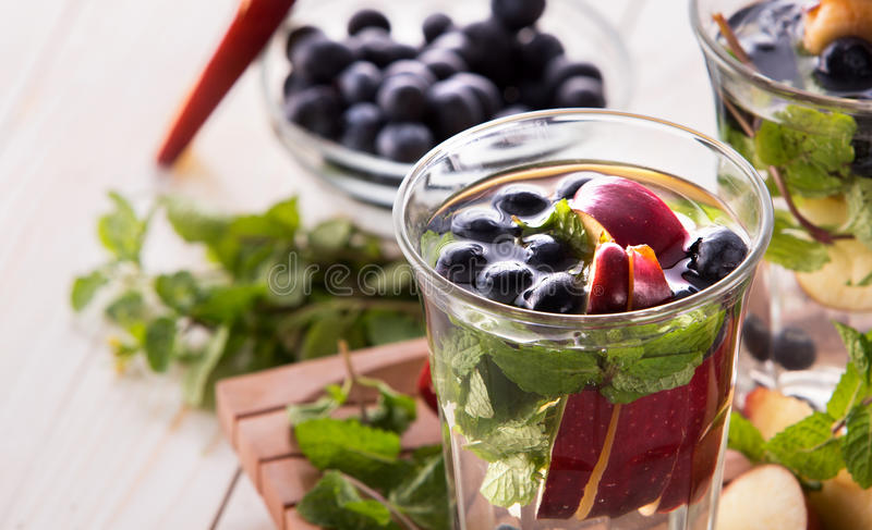 Fresh fruit Flavored infused water mix of blueberry, apple and m royalty free stock photo