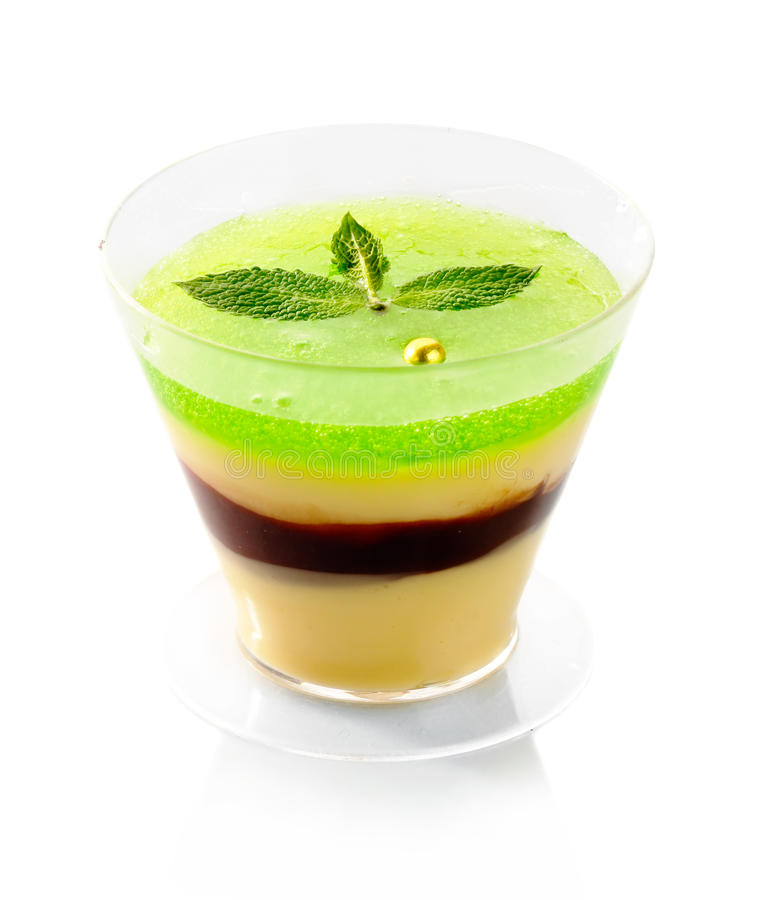 Fresh fruit jelly with green mint isolated. On white background stock photo