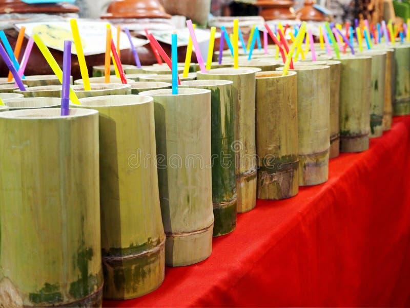 Fresh Fruit Juice in Bamboo Tubes royalty free stock photos