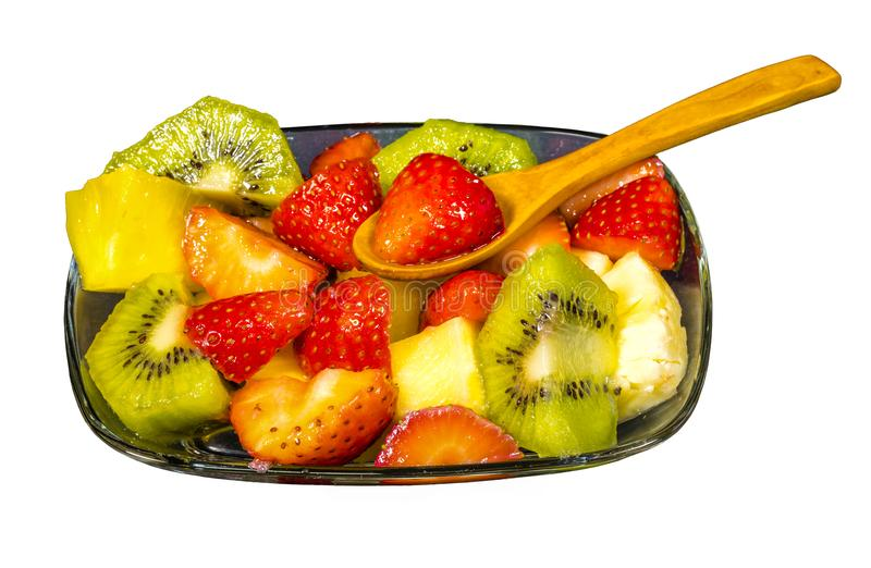 Fresh fruit macedonia cut into cubes. Isolated blank background with spoon stock photo