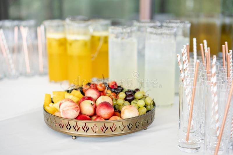 Fresh Fruit platter buffet at business or wedding event venue. Self service or all you can eat - cherries, nectarine. Grapes and pineapple royalty free stock photography