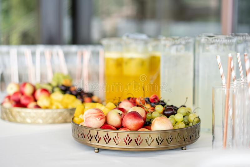 Fresh Fruit platter buffet at business or wedding event venue. Self service or all you can eat - cherries, nectarine. Grapes and pineapple stock photos