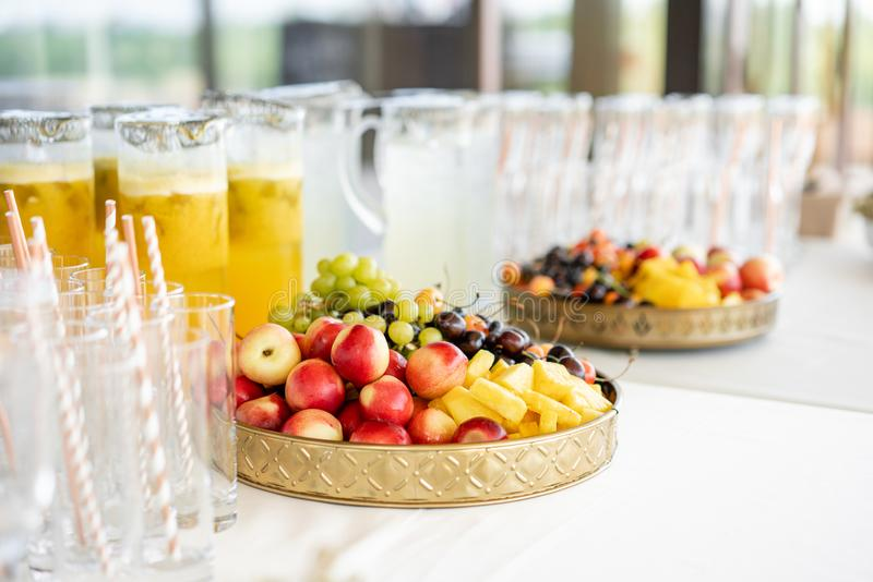 Fresh Fruit platter buffet at business or wedding event venue. Self service or all you can eat - cherries, nectarine. Grapes and pineapple royalty free stock photos