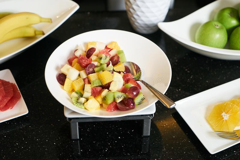 Fresh fruit salad with sliced grape, strawberry, kiwi, melon and royalty free stock photos
