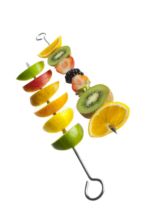 Fresh fruit on a skewer royalty free stock photo