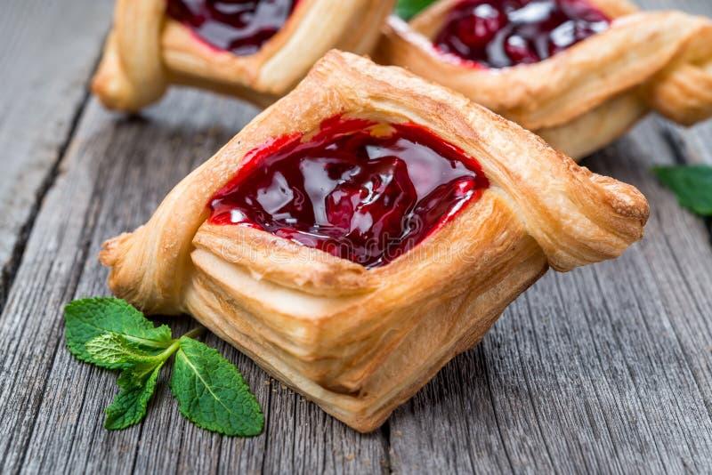 Fresh fruit tart with berries jam , mint on wooden background. Desert. stock images
