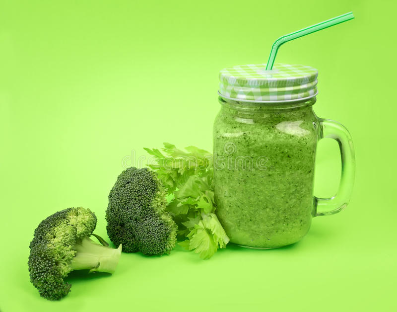 Fresh fruit vegetable broccoli celery smoothie, shake lime green background. detox cocktail royalty free stock image