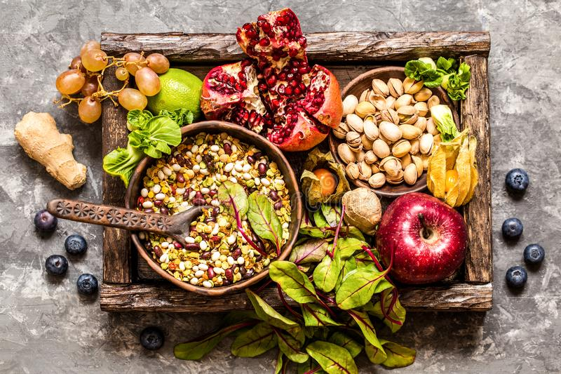 Fresh fruit, vegetables, cereals, nuts and greens, the ingredients for a healthy lifestyle, healthy eating stock photos