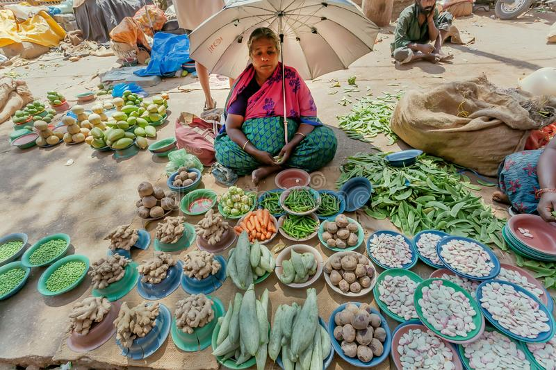 Fresh fruit and vegetables market with local traders of ginger, potatoes, beans and greens stock photography