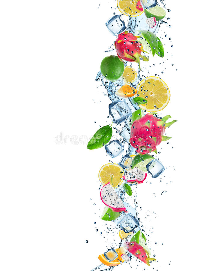 Fresh fruit with water splash and ice cubes. Over white background royalty free stock photo