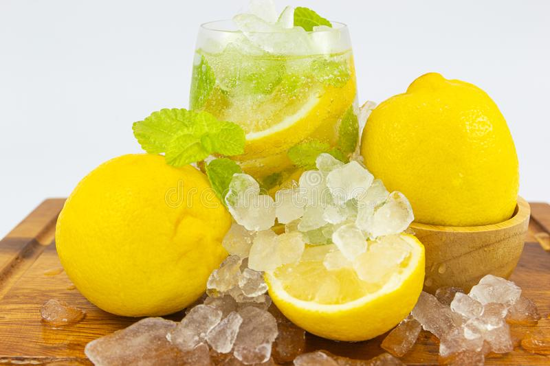 Fresh Fruit Yellow lemon in glass on wood for hot summer days. And good for health royalty free stock images