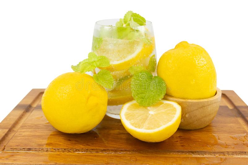 Fresh Fruit Yellow lemon in glass on wood for hot summer days. And good for health isolated white background stock photos