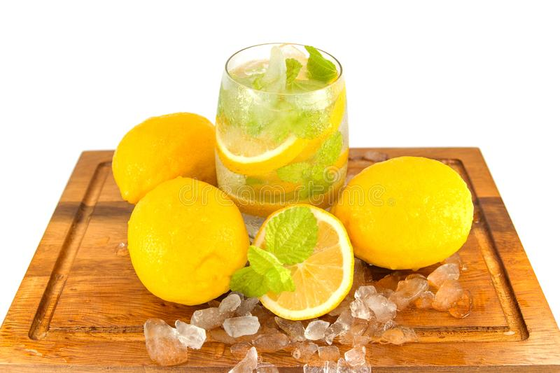 Fresh Fruit Yellow lemon in glass on wood for hot summer days. And good for health isolated white background royalty free stock images