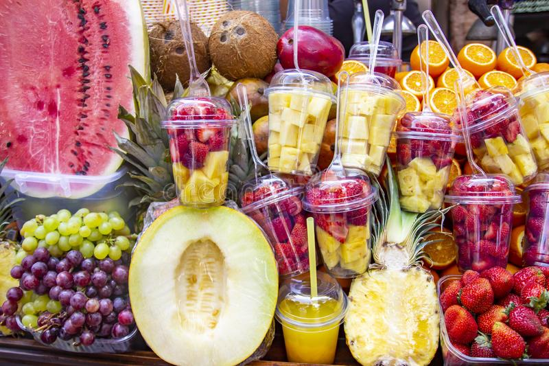 Fresh fruits background.Healthy eating, dieting concept, clean eating. Various freshly squeezed fruits and vegetables juices. Fresh fruits juices stock photo