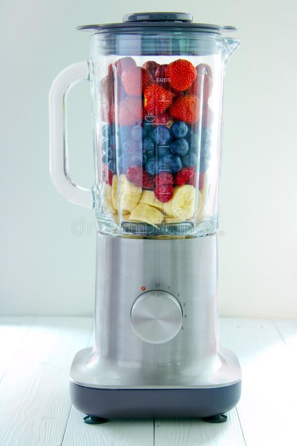 Electric blender with berries stock images