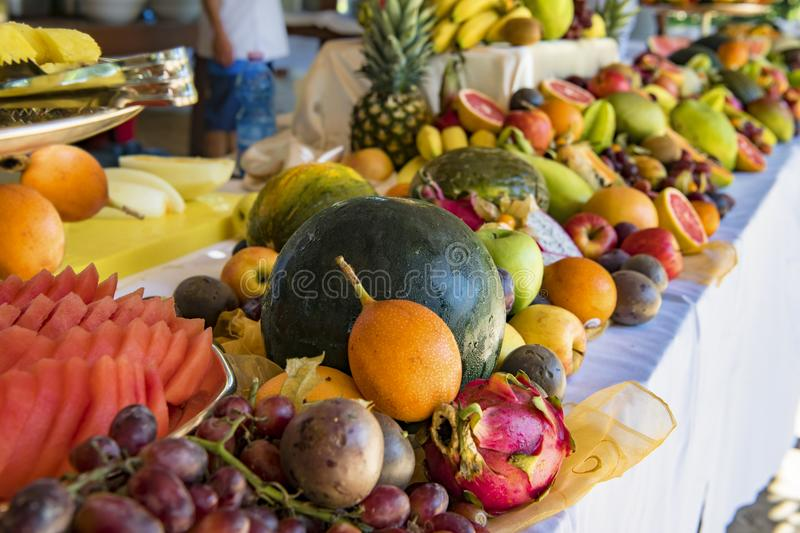 Fresh Fruits on buffet: melon, apples, grapes, tamarillo, passion fruit royalty free stock photography