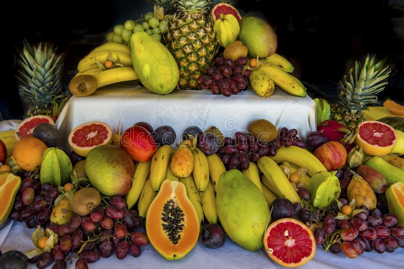 Fresh Fruits on buffet: oranges, bananas, grapes, pineapple, passion fruit royalty free stock photos