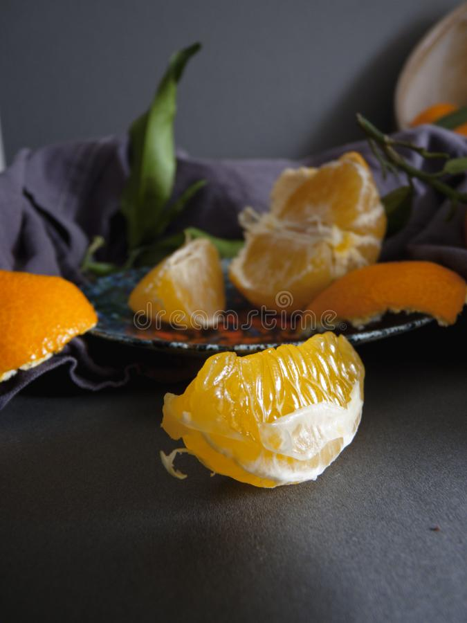 Clementines foreground. Fruit salad royalty free stock photo