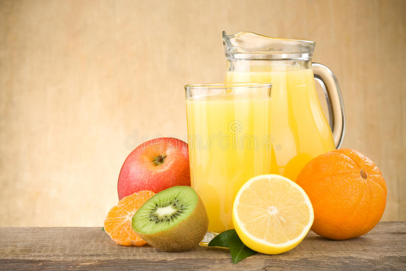 Download Fresh Fruits Juice In Glass And Slices On Wood Stock Image - Image: 24697465