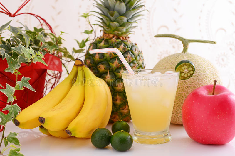Fresh fruits with juice stock image